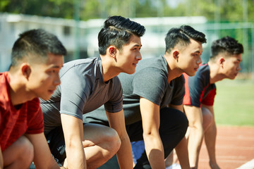 young asian sprinters on starting line