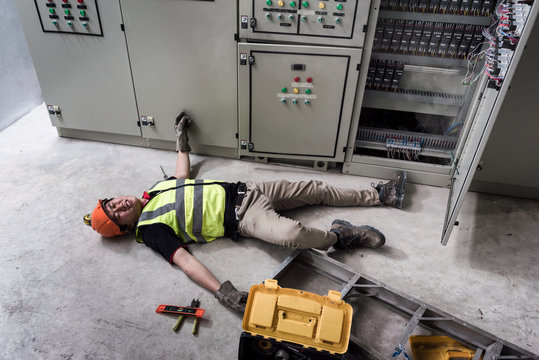 Accident at work of electrician people or Maintenance worker in the control room of factory.