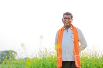 Indian farmer at black musterd field