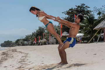 Filipino couple at the beach and yoga poses