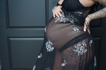 Couples in black pregnant wife