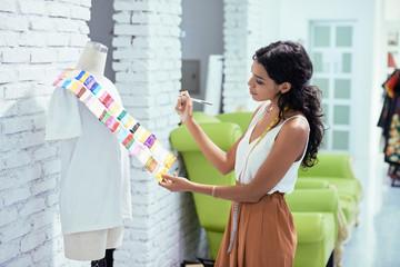 Seamstress choosing fabric for new dress