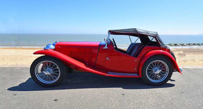 Classic Red Sports Car parked on Seafront  Promenade.