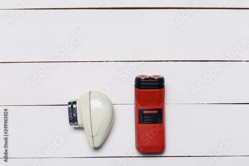 Retro electric shave machine on wooden background Old
