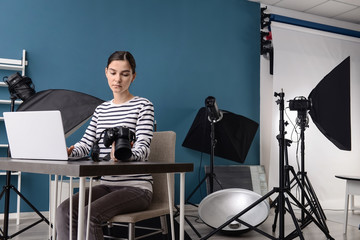 Female photographer working in professional studio