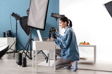 Female photographer working in professional studio
