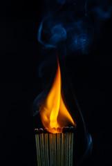 Match, smoke and flame