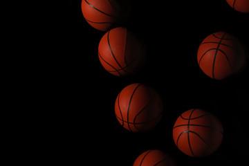 Stroboscopic photo of moving ball on dark background