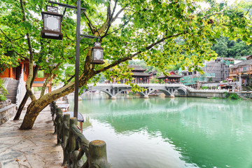 Amazing view of the Tuojiang River among green trees, Fenghuang