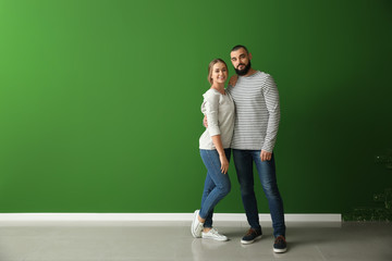 Happy young couple near color wall Wall mural