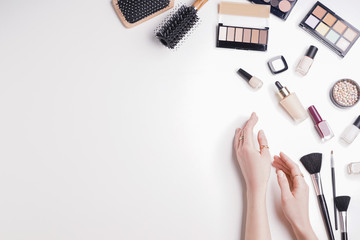 Beauty blogger with makeup cosmetics on white background