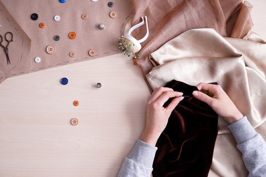 Female tailor working on light table