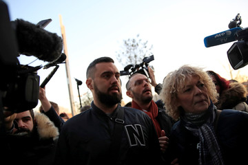 French 'yellow vests' leader Eric Drouet arrives with his lawyer Kheops Lara to attend his trial at the courthouse in Paris