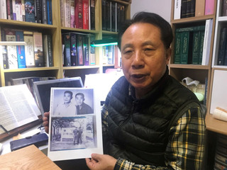 Ahn Yong-soo, whose brother was a South Korean prisoner of war captured by communist Vietnamese during the Vietnam War and sold to North Korean military officers, poses for photographs with a picture of his brother, at his home in Seoul, South Korea