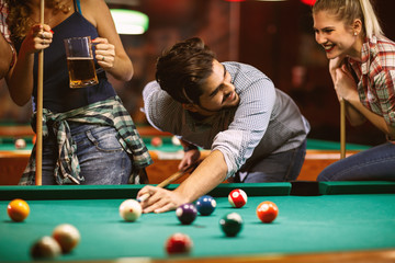 handsome smiling man playing billiard game.