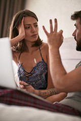 Man discussion with woman in the bed Modern lifestyle concept..