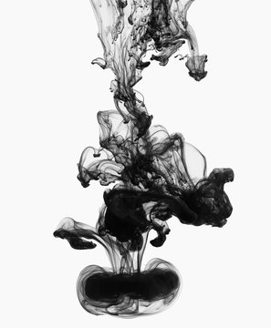 Acrylic black ink in water, isolated on white