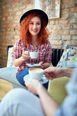 Pretty curly girl drinking coffee