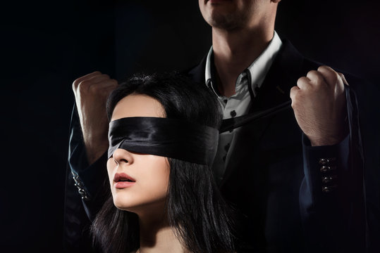 Couple Love Kiss, Sexy Blindfolded Woman and elegant Man in Suit