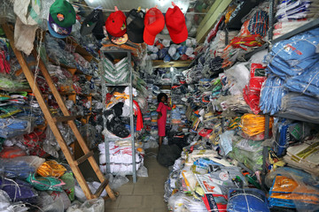 A woman stands inside a shop in Abuja