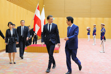 Austria's Chancellor Sebastian Kurz  talks with Japan's Prime Minister Shinzo Abe after the review of the guard of honor during a welcoming ceremony prior the Japan-Austria Summit meeting at the prime minister's office in Tokyo