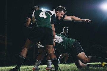Rugby players competing in match
