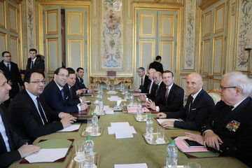 French President Emmanuel Macron meets Tunisia's PM Youssef Chahed at the Elysee Palace in Paris