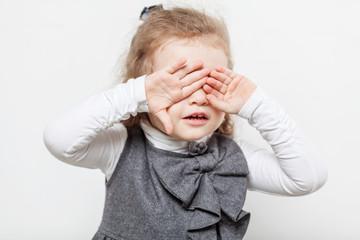 Cute little girl, evil emotion, close-up, light background