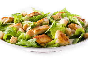 Caesar salad with lettuce,chicken and croutons isolated on white background. Close up