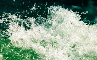 Splashes of water from the waves in the sea