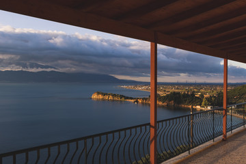 Sea view from balcony, mountains in background, in Greece.