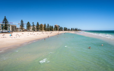 Distant view of Glenelg beach in Adelaide suburb on hot sunny summer day in SA Australia