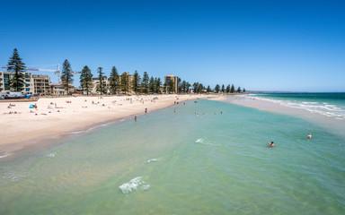Foto auf Gartenposter Olivgrun Distant view of Glenelg beach in Adelaide suburb on hot sunny summer day in SA Australia