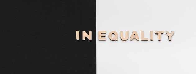 Word Inequality written on black and white background