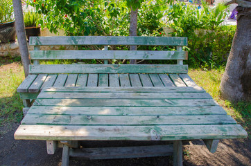 wooden table with bench green gray in nature