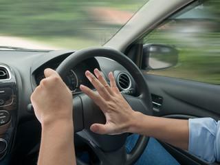 Driver Pressing Car Horn