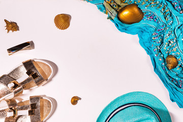 Pure white background, handkerchief, hat, lipstick, Golden seashells, Slippers, summer concept. Flat lay. A place for your inscription.