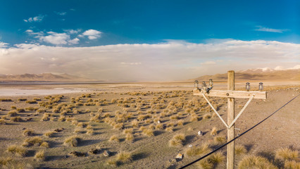 Old electric pole and Desert Lake near Mount Erciyes in Kayseri Turkey