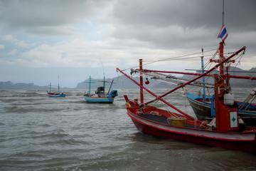 Thai long tail boat during low tide in ocean
