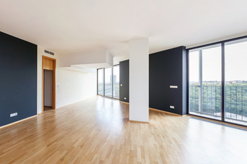 Modern white empty loft apartment interior with parquet floor with black column and panoramic windows, Overlooking the metropolis city