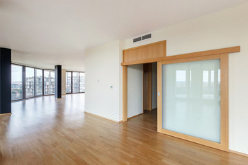 Modern white empty loft apartment interior with parquet floor and panoramic windows, Overlooking the metropolis city