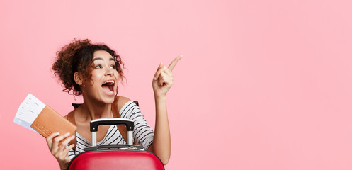 Excited woman with tickets pointing finger away