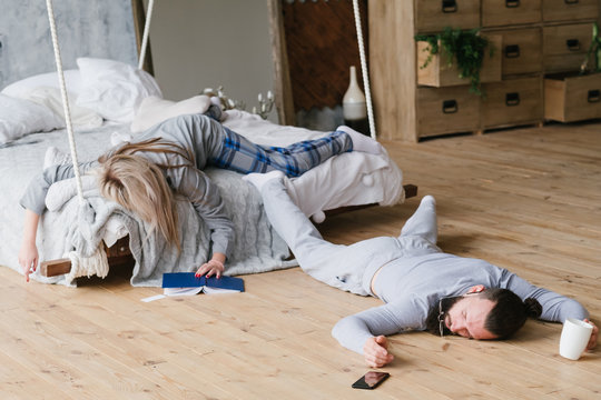 No night sleep. Exhausted workaholic couple fell asleep chaotically.