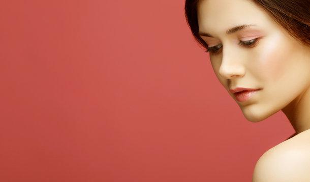 close up of beautiful woman wearing shiny diamond earrings