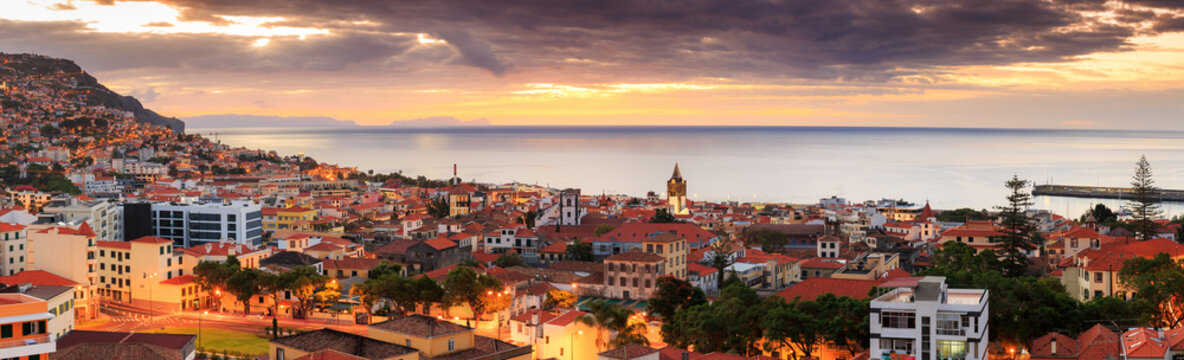 Beautiful panoramic cityscape of the skyline of the city Funchal on the island Madeira at sunrise in summer