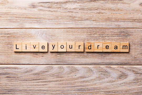 live your dream word written on wood block. live your dream text on wooden table for your desing, concept