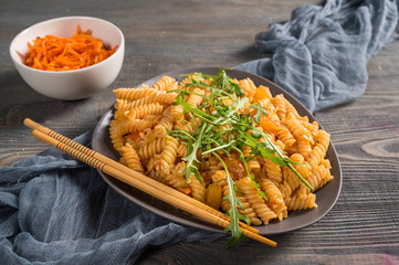 Pasta with spicy tomato sauce and herbs