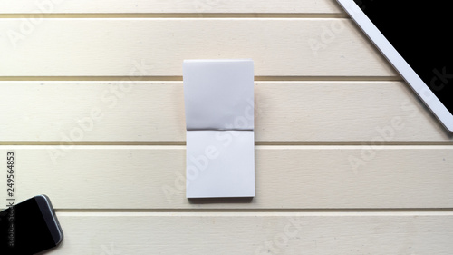Wall mural taplet top view copy space with smart phone and notebook on wood background