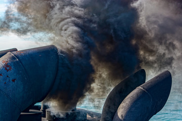 Ship discharging black smoke from the chimney