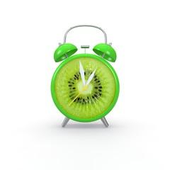 Kiwi slice alarm clock on white background